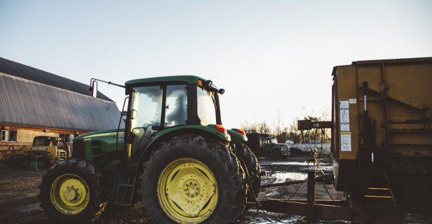 Farmer Driving Green Tractor